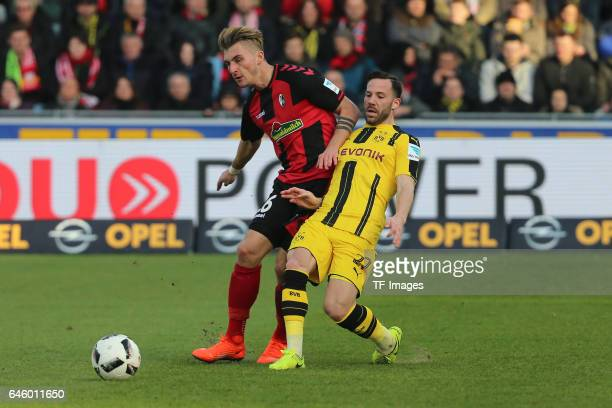 Maximilian Philipp of Freiburg and Gonzalo Castro of Dortmund battle for the ball during the Bundesliga match between Sport Club Freiburg and...