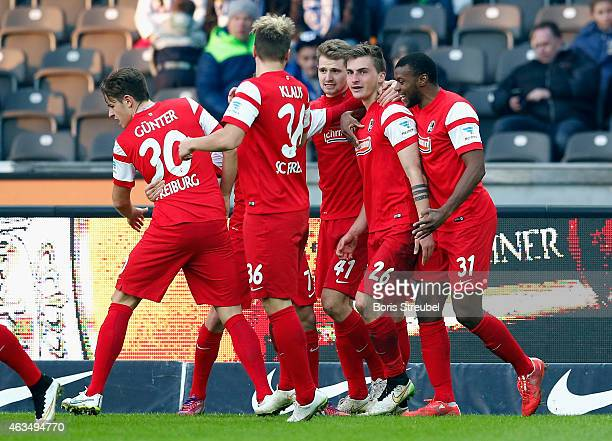 Maximilian Philipp of Freiburg celebrates with team mates after scoring his team's second goal during the Bundesliga match between Hertha BSC and SC...