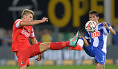 Maximilian Philipp of Freiburg challenges Hajime Hosogai of Hertha BSC during the Bundesliga match between SC Freiburg and Hertha BSC at Mage Solar...