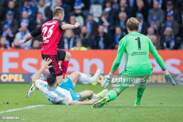Maximilian Philipp of Freiburg is fouled for a penalty kick by Sead Kolasinac of Schalke during the Bundesliga match between SC Freiburg and FC...