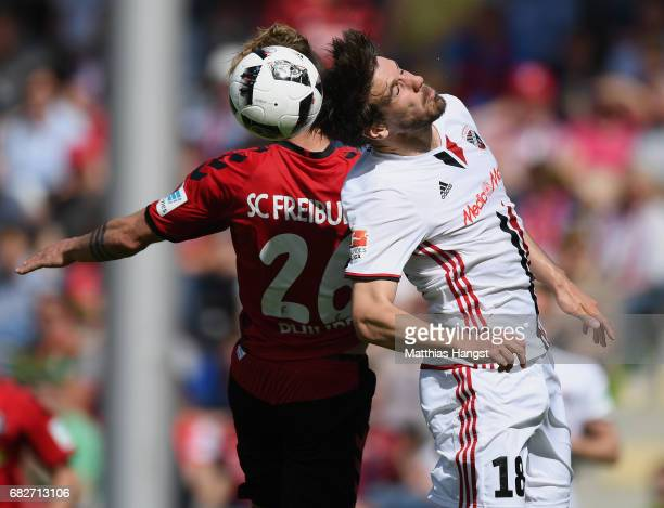 Maximilian Philipp of Freiburg jumps for a header with Romain Bregerie of Ingolstadt during the Bundesliga match between SC Freiburg and FC...