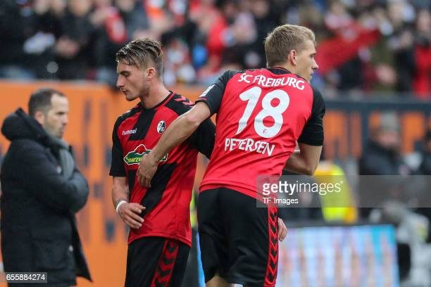 Maximilian Philipp of Freiburg shakes hands with Nils Petersen of Freiburg during the Bundesliga match between FC Augsburg and SC Freiburg at WWK...