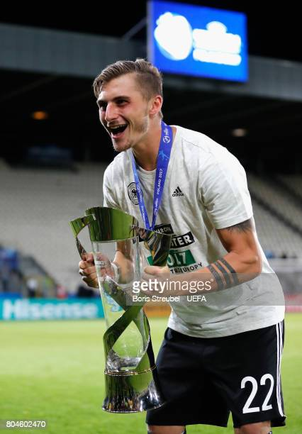 Maximilian Philipp of Germany celebrates with the trophy after the UEFA European Under21 Championship Final between Germany and Spain at Krakow...
