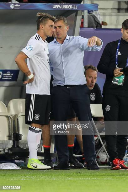 Maximilian Philipp of Germany Coach Stefan Kuntz of Germany during the UEFA U21 championship match between Italy and Germany at Krakow Stadium on...