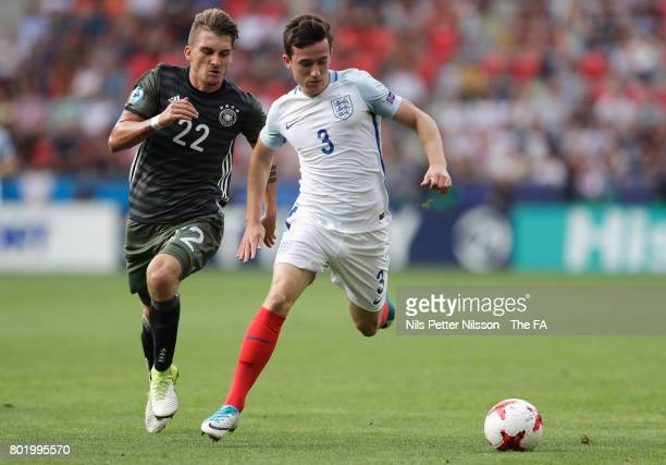 Maximilian Philipp of Germany puts pressure on Ben Chilwell of England during the UEFA European Under21 Championship Semi Final match between England...