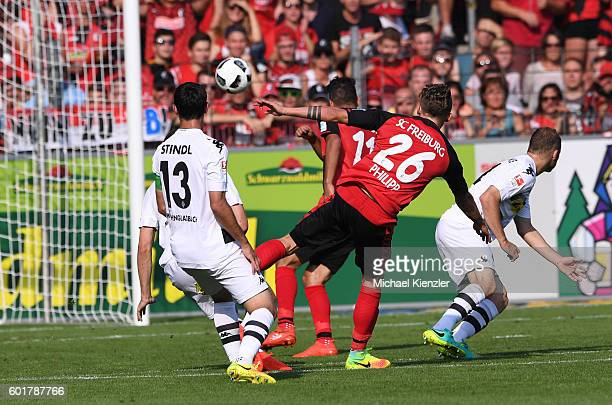 Maximilian Philipp of SC Freiburg shoot first goal for Freiburg during the Bundesliga match between Sport Club Freiburg and Borussia Moenchengladbach...
