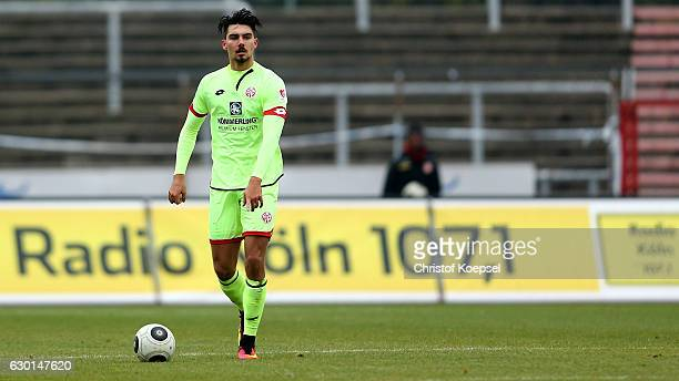 Maximilian Rossmann of Mainz runs with the ball during the Third League match between Fortuna Koeln an FSV Mainz 05 II at Suedstadion on December 17...