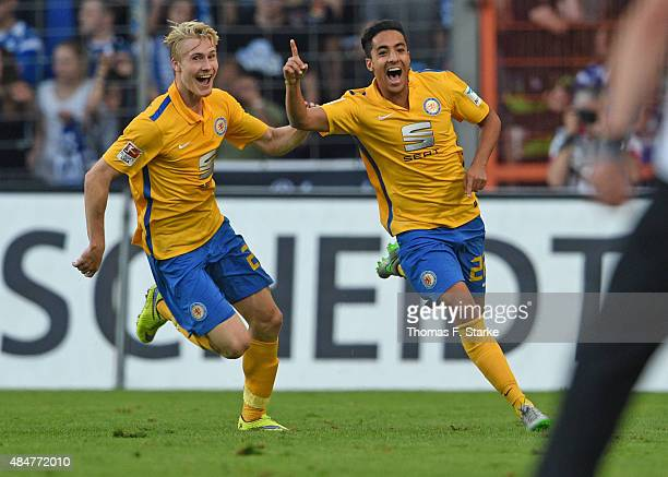 Maximilian Sauer and Salim Khelifi celebrate their teams second goal during the Second Bundesliga match between Arminia Bielefeld and Eintracht...