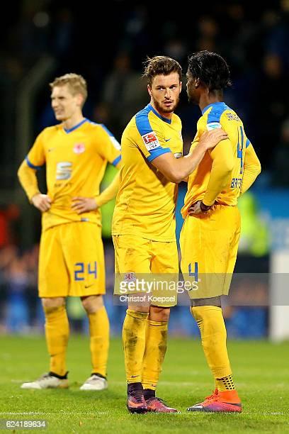 Maximilian Sauer Quirin Moll and Joseph Baffo of Braunschweig look dejected after the Second Bundesliga match between VfL Bochum 1848 and Eintracht...