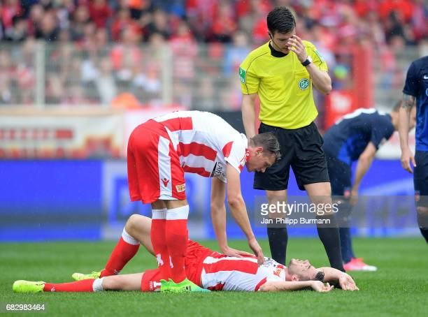 Maximilian Thiel Dennis Daube of 1FC Union Berlin and referee Harm Osmers during the game between 1st FC Union Berlin and 1st FC Heidenheim on May 14...