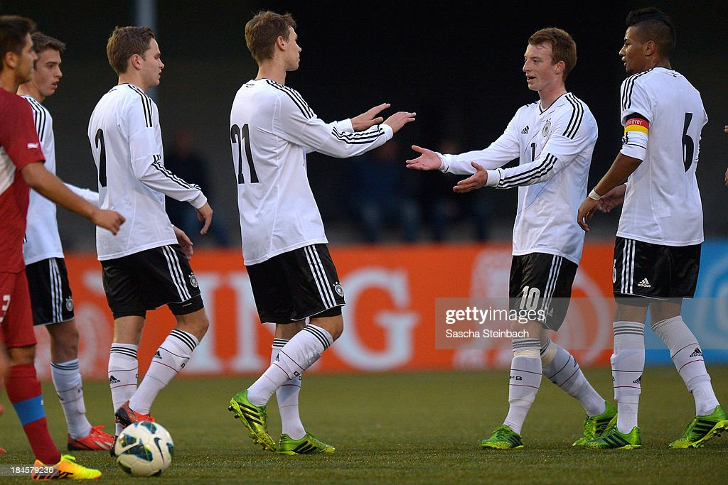 Maximilian Thiel of Germany celebrates after scoring the opening goal with team mates during the U20 juniors tournament match between the Czech Republic and Germany on October 14, 2013 in Gemert, Netherlands.