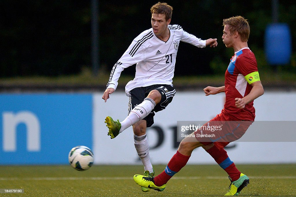 Maximilian Thiel (L) of Germany scores his team's opening goal during the U20 juniors tournament match between the Czech Republic and Germany on October 14, 2013 in Gemert, Netherlands.