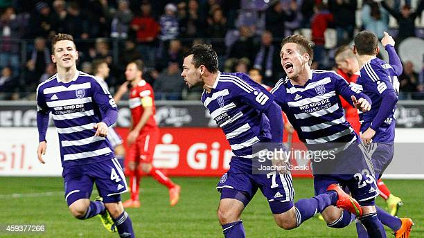 Maximilian Wagener Goalgetter Massimo Ornatelli and Michael Hohnstedt of Osnabrueck clebrate the 21 during the Third League match between VfL...
