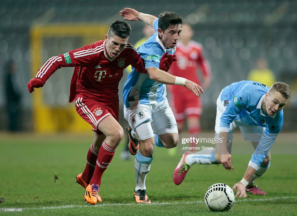 Maximilian Wittek (C) and Korbinian Burger (R) of 1860 Muenchen battles for the ball with Steeven Ribery (L) of FC Bayern during the A Juniors Bundesliga match between 1860 Muenchen and Bayern Muenchen at Stadion an der Gruenwalder Strasse on February 21, 2014 in Munich, Germany.