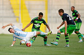 Maximilian Wittek of 1860 Muenchen battles for the ball with Kyle Naughton and Gylfi Sigurdsson of Swansea during the preseason friendly match...
