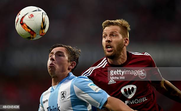 Maximilian Wittek of Muenchen and Guido Burgstaller of Nuernberg compete for the ball during the second Bundesliga match between 1 FC Nuernberg and...
