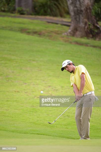 Maximiliano Godoy of Colombia chips up to the 17th hole during the final round of the PGA TOUR Latinoamérica Flor de Cana Open at Mukul Beach Golf...