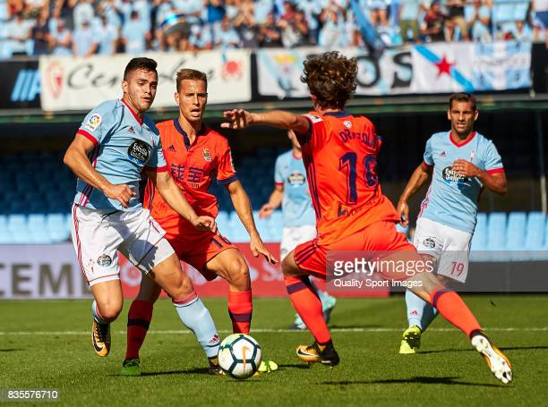 Maximiliano Gomez of Celta de Vigo competes for the ball with Alvaro Odriozola of Real Sociedad during the La Liga match between Celta de Vigo and...