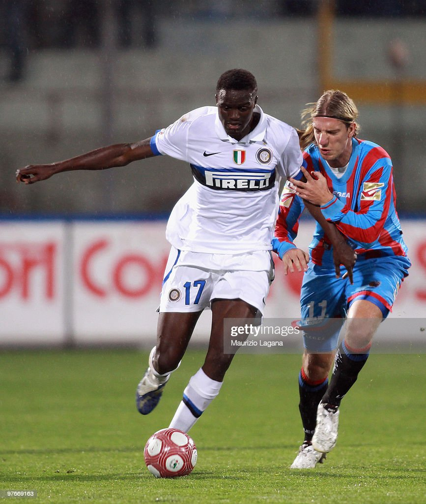 Maximiliano Maxi Lopez of Catania Calcio battles for the ball with Mc Donald Mariga of FC Internazionale Milano during the Serie A match between...