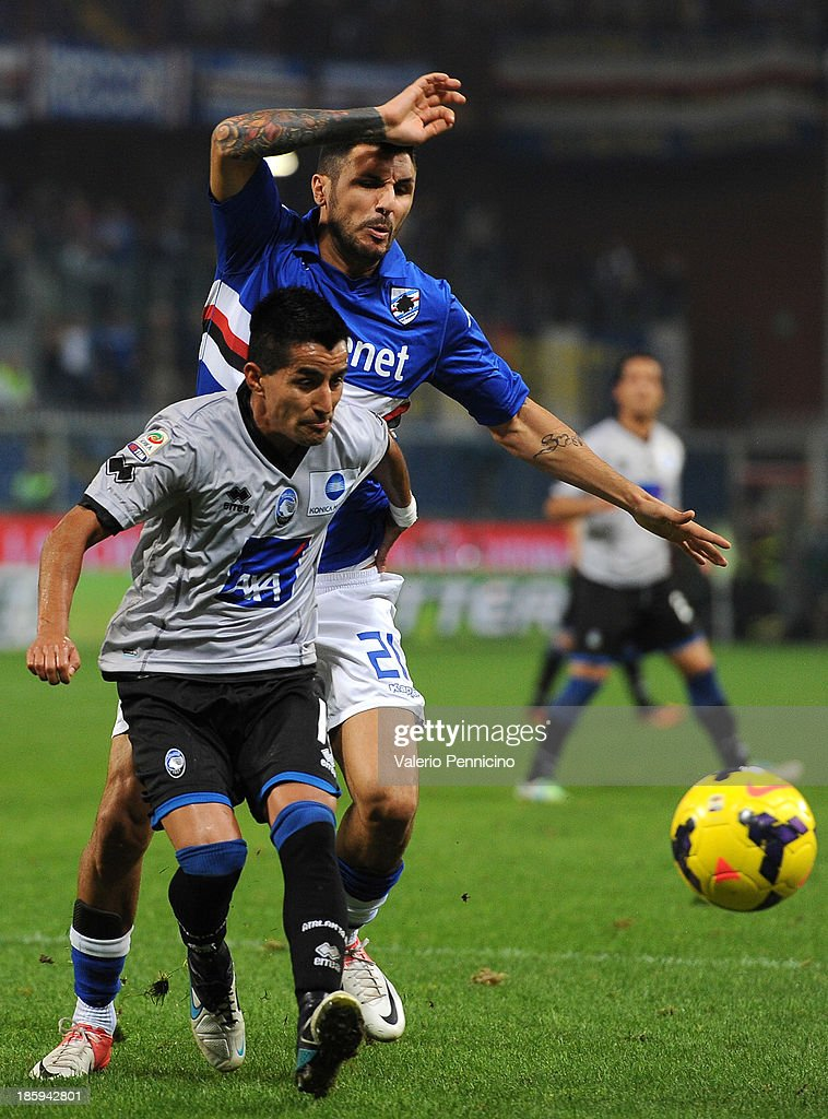 Maximiliano Moralez (L) of Atalanta BC is challenged by Roberto Soriano of UC Sampdoria during the Serie A match between UC Sampdoria and Atalanta BC at Stadio Luigi Ferraris on October 26, 2013 in Genoa, Italy.