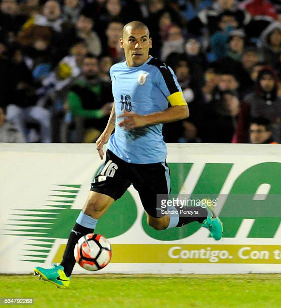 Maximiliano Pereira of Uruguay drives the ball during an international friendly match between Uruguay and Trinidad Tobago at Centenario Stadium on...