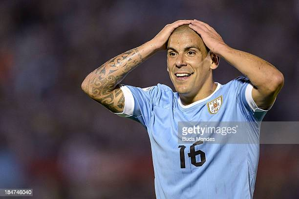 Maximiliano Pereira of Uruguay laments losing a goal during a match between Uruguay and Argentina as part of the 18th round of the South American...