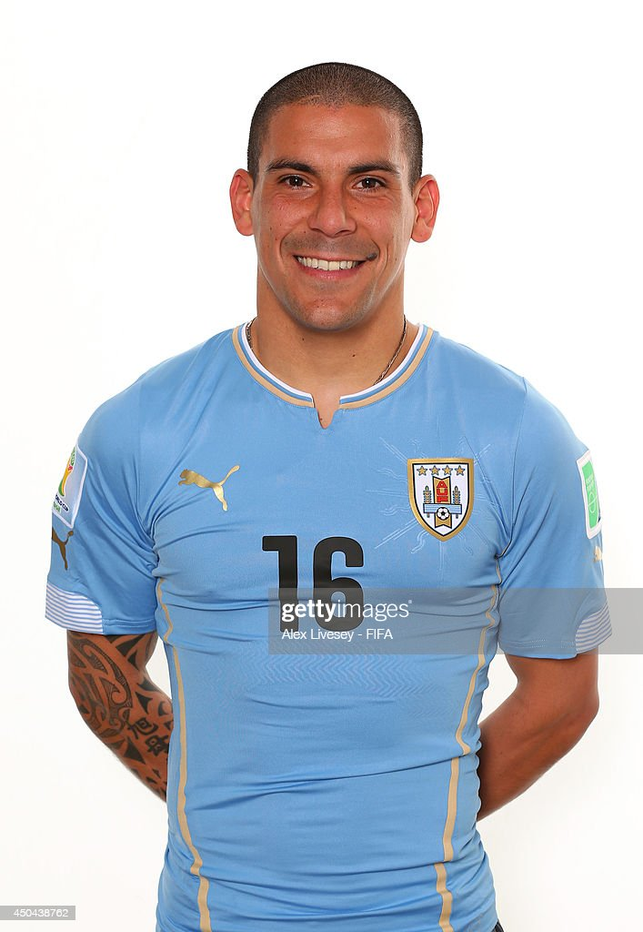 Maximiliano Pereira of Uruguay poses during the official FIFA World Cup 2014 portrait session on June 10, 2014 in Belo Horizonte, Brazil.