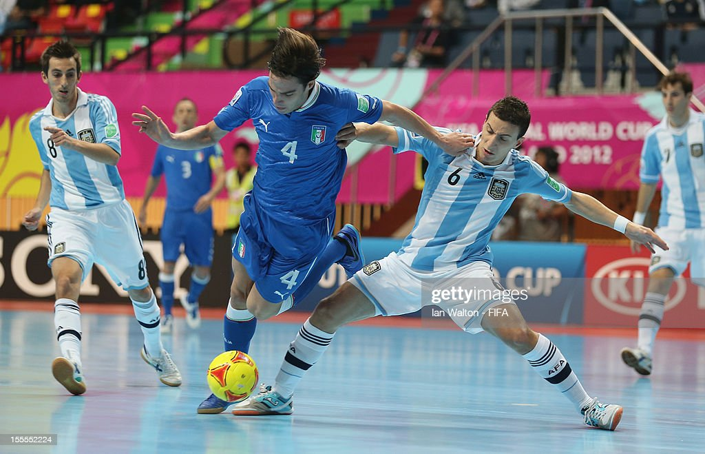 Maximiliano Rescia of Argentina tries to tackle Sergio Romano of Italy during the FIFA Futsal World Cup Thailand 2012, Group D match between Argentina and Italy at Nimibutr Stadium on November 5, 2012 in Bangkok, Thailand.
