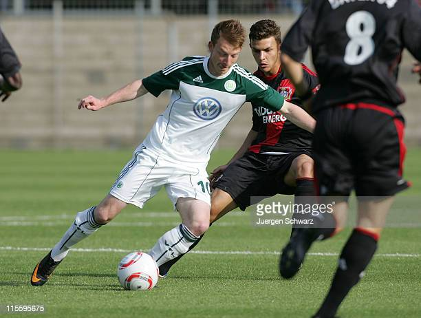 Maximillian Arnold of Wolfsburg controls the ball next to Daniel von der Bracke of Leverkusen during the A Junior Championships semifinal first leg...