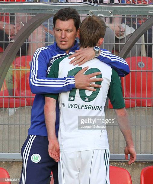 Maximillian Arnold of Wolfsburg is hugged by coach Stephan Schmidt leaving the pitch during the A Junior Championships semifinal first leg match...