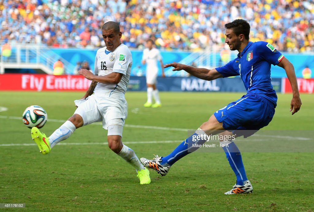 Maximilliano Pereira of Uruguay attempts to block Mattia De Sciglio of Italy during the 2014 FIFA World Cup Brazil Group D match between Italy and Uruguay at Estadio das Dunas on June 24, 2014 in Natal, Brazil.