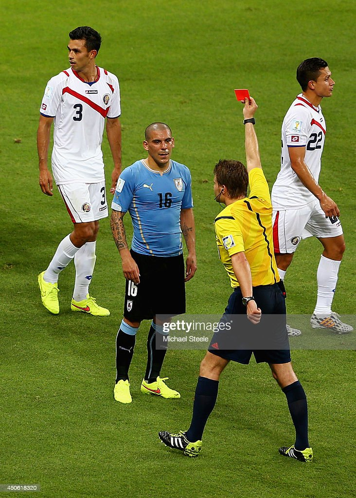 Maximilliano Pereira of Uruguay is shown a red card by referee <a gi-track='captionPersonalityLinkClicked' href=/galleries/search?phrase=Felix+Brych&family=editorial&specificpeople=707645 ng-click='$event.stopPropagation()'>Felix Brych</a> after a foul during the 2014 FIFA World Cup Brazil Group D match between Uruguay and Costa Rica at Castelao on June 14, 2014 in Fortaleza, Brazil.