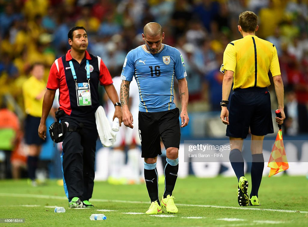 Maximilliano Pereira of Uruguay leaves the pitch after being sent off during the 2014 FIFA World Cup Brazil Group D match between Uruguay and Costa Rica at Estadio Castelao on June 14, 2014 in Fortaleza, Brazil.