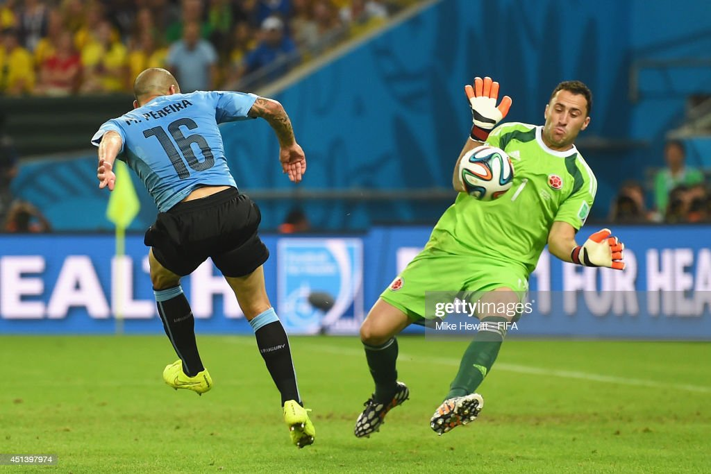 Maximilliano Pereira of Uruguay shoots while <a gi-track='captionPersonalityLinkClicked' href=/galleries/search?phrase=David+Ospina&family=editorial&specificpeople=4104267 ng-click='$event.stopPropagation()'>David Ospina</a> of Colombia makes a save during the 2014 FIFA World Cup Brazil Round of 16 match between Colombia and Uruguay at Maracana on June 28, 2014 in Rio de Janeiro, Brazil.
