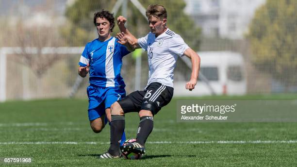Maximo Tolonen of Finland challenges Lars Lukas Mai of Germany during the UEFA U17 elite round match between Germany and Finland on March 25 2017 in...