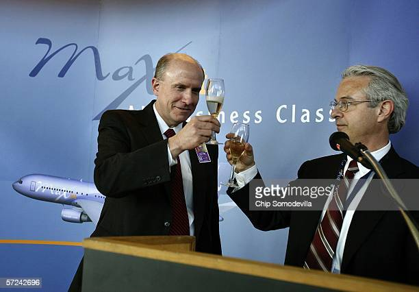 MAXjet Airways Chief Executive Officer Gary Rogliano and Metropolitan Washington Airports Authority President and CEO James Bennett toast champagne...