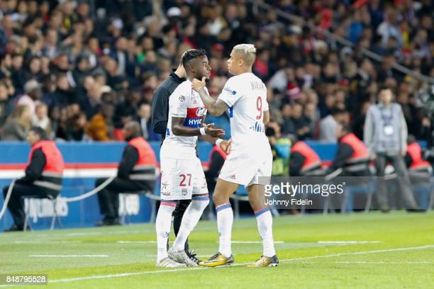 Maxwel Cornet and Mariano of Lyon during the Ligue 1 match between Paris Saint Germain and Olympique Lyonnais at Parc des Princes on September 17...