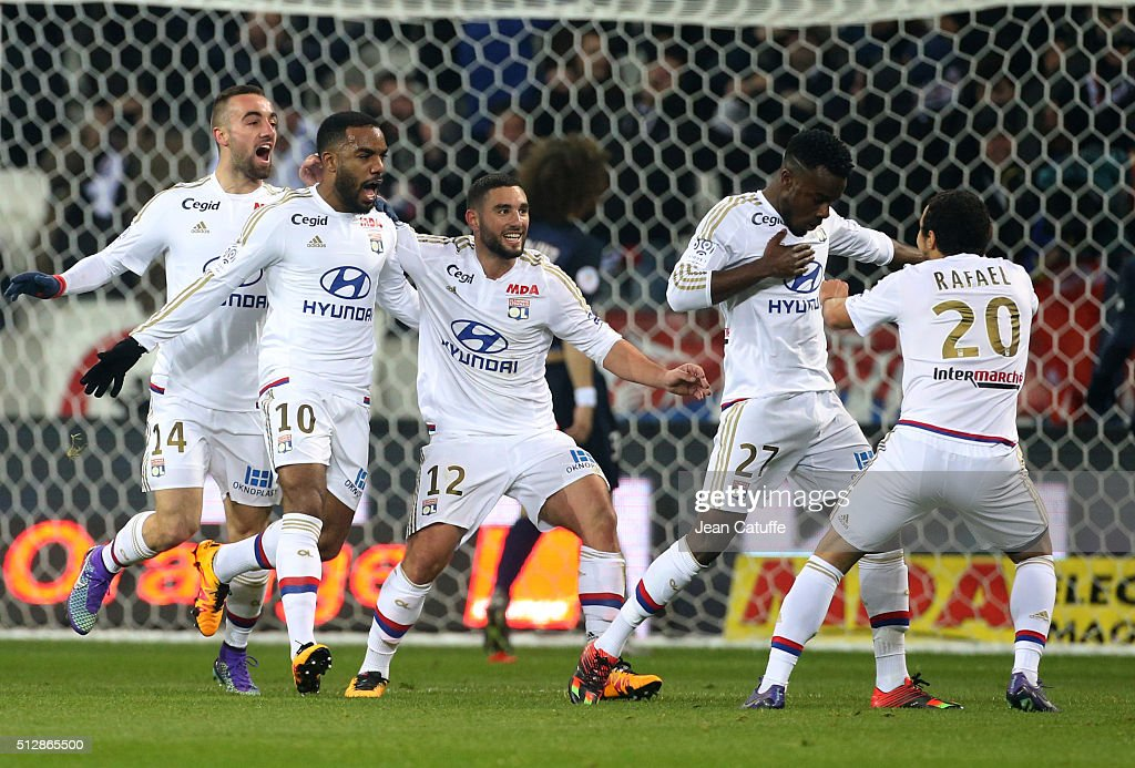 Maxwel Cornet of Lyon (#27) celebrates his goal with teammates Sergi Darder, <a gi-track='captionPersonalityLinkClicked' href=/galleries/search?phrase=Alexandre+Lacazette&family=editorial&specificpeople=6927653 ng-click='$event.stopPropagation()'>Alexandre Lacazette</a>, Jordan Ferri, Rafael da Silva of Lyon during the French Ligue 1 match between Olympique Lyonnais (OL) and Paris Saint-Germain (PSG) at Parc Olympique Lyonnais stadium (Parc OL) on February 28, 2016 in Lyon, France.