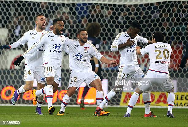 Maxwel Cornet of Lyon celebrates his goal with teammates Sergi Darder Alexandre Lacazette Jordan Ferri Rafael da Silva of Lyon during the French...