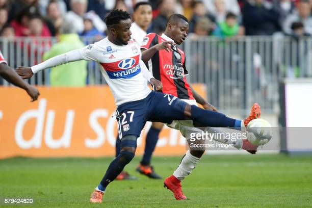 Maxwel Cornet of Olympique Lyon Jean Michael Seri of Nice during the French League 1 match between Nice v Olympique Lyon at the Allianz Riviera on...