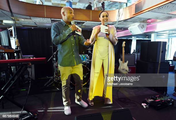 Maxwell and Brand Ambassador Tia Mowry speak onstage during 'Picnic Time Off' to celebrate the global launch of LEMON LEMON on the Hornblower...