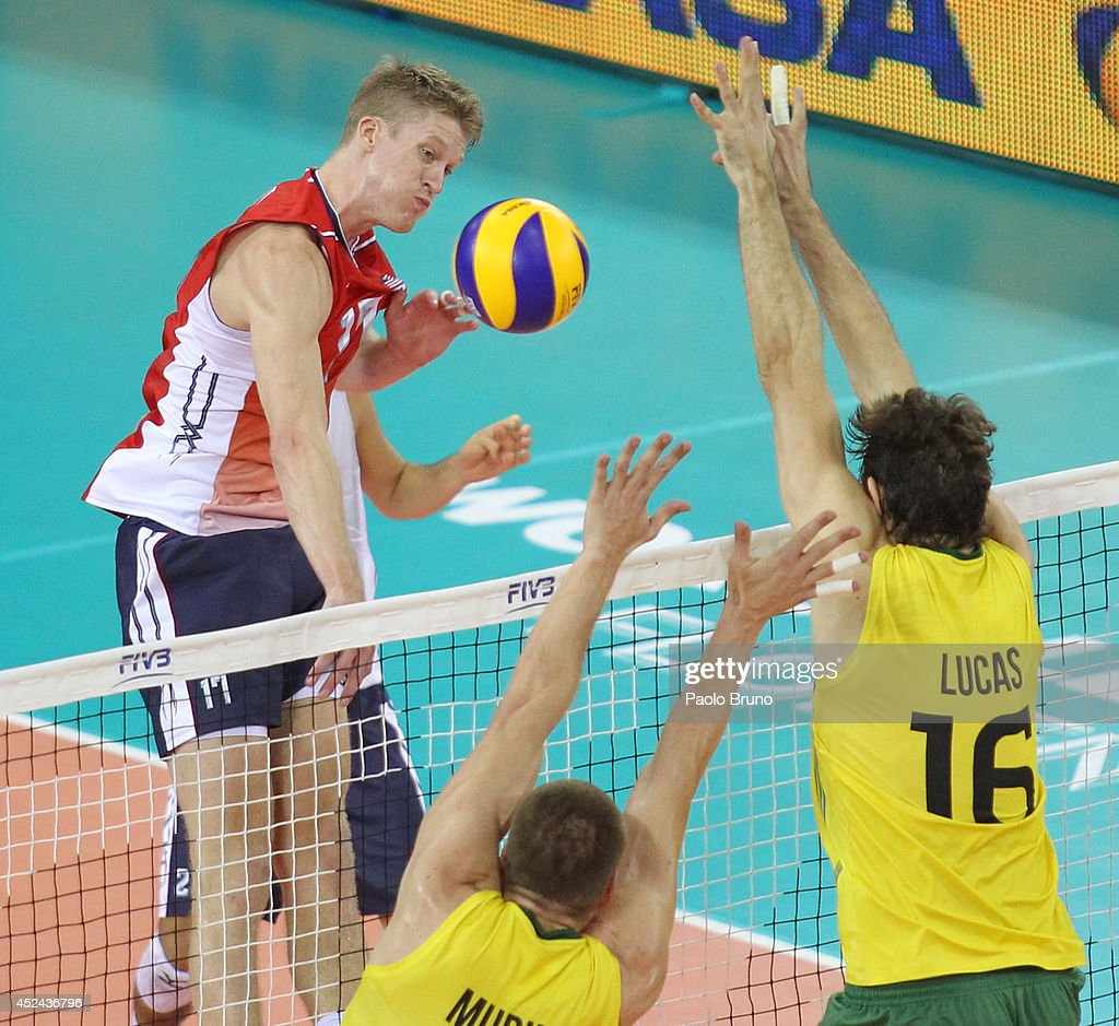 Maxwell Holt of United States spikes the ball as Saatkamp Lucas with his teammate of Brazil block during the FIVB World League Final Six match for the first place between United States and Brazil at Mandela Forum on July 20, 2014 in Florence, Italy.