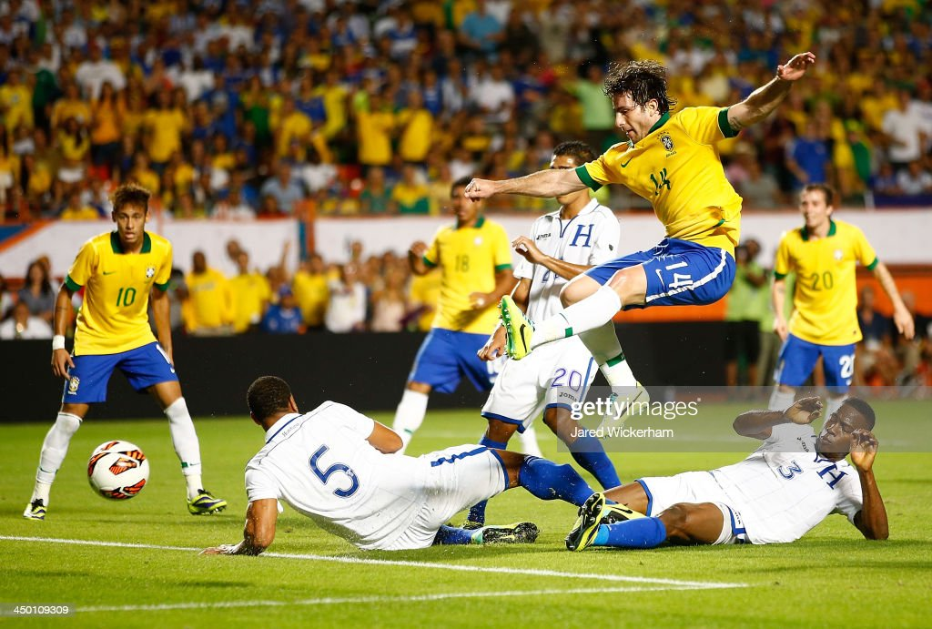 <a gi-track='captionPersonalityLinkClicked' href=/galleries/search?phrase=Maxwell+-+Brazilian+Soccer+Player&family=editorial&specificpeople=546154 ng-click='$event.stopPropagation()'>Maxwell</a> #14 of Brazil takes a shot on goal in front of <a gi-track='captionPersonalityLinkClicked' href=/galleries/search?phrase=Lucas+Leiva+-+Defensive+Midfielder+-+Born+1987&family=editorial&specificpeople=4114250 ng-click='$event.stopPropagation()'>Lucas Leiva</a> #5 of Honduras in the first half during a friendly match at Sun Life Stadium on November 16, 2013 in Miami Gardens, Florida.