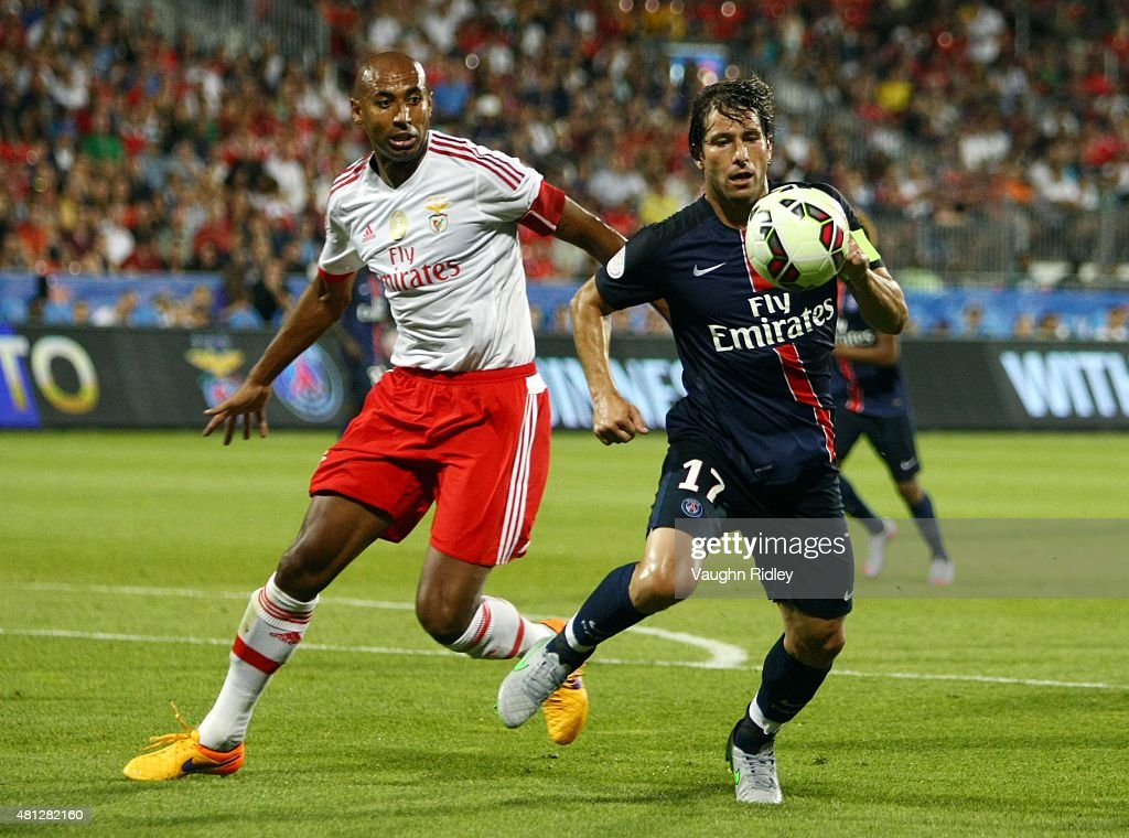 Maxwell #17 of Paris Saint-Germain and Luisao #4 of Benfica battle for the ball during the 2015 International Champions Cup match at BMO Field on July 18, 2015 in Toronto, Ontario, Canada.