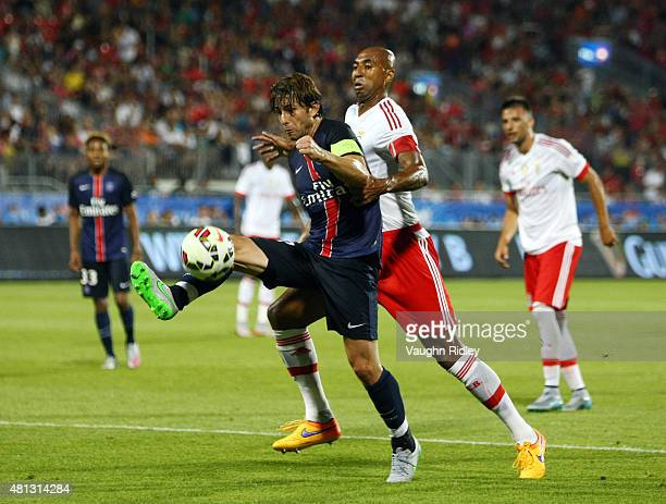 Maxwell of Paris SaintGermain and Luisao of Benfica battle for the ball during the 2015 International Champions Cup match at BMO Field on July 18...