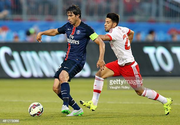 Maxwell of Paris SaintGermain and Pizzi of Benfica battle for the ball during the 2015 International Champions Cup match at BMO Field on July 18 2015...