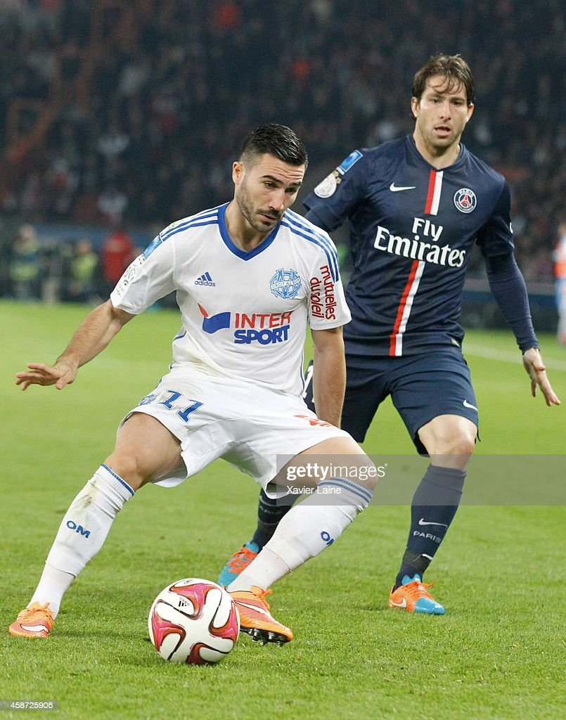 Maxwell of Paris Saint-Germain and <a gi-track='captionPersonalityLinkClicked' href=/galleries/search?phrase=Romain+Alessandrini&family=editorial&specificpeople=9572619 ng-click='$event.stopPropagation()'>Romain Alessandrini</a> #11 of Olympique de Marseille in action during the French Ligue 1 between Paris Saint-Germain FC and Olympique de Marseille at Parc Des Princes on November 09, 2014 in Paris, France.