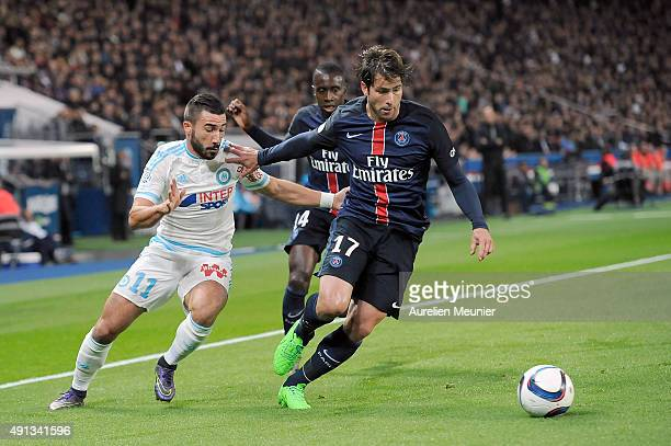 Maxwell of Paris SaintGermain and Romain Alessandrini of Olympique de Marseille fight for the ball during the Ligue 1 game between Paris SaintGermain...