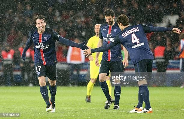 Maxwell of Paris SaintGermain celebrate his goal with Benjamin Stambouli and Thiago Motta during the French Ligue 1 match between Paris SaintGermain...