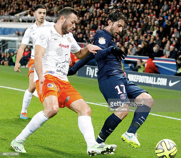 Maxwell of Paris SaintGermain in action with Jamel Saihi of Montpellier Herault SC during the French Ligue 1 between Paris SaintGermain FC and...